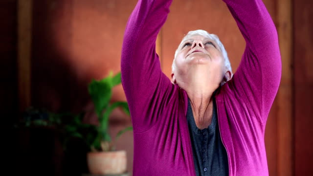 Video portrait senior woman in yoga prayer position