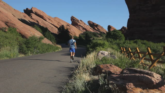 hd video road running red rocks park colorado - red rocks stock videos & royalty-free footage