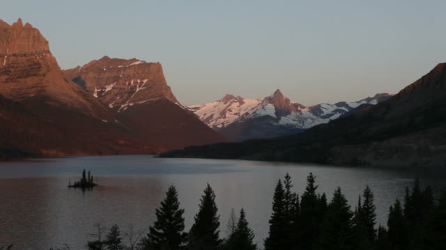 hd video saint mary lake snowy mountains glacier national park - glacier national park us stock videos and b-roll footage