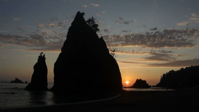 hd video sea stack sunset in olympic national park - stack rock stock videos and b-roll footage