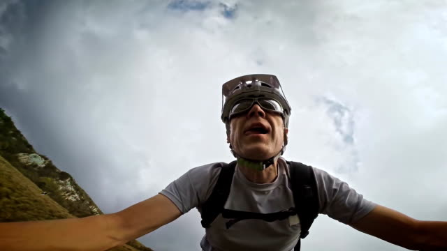 Video selfie of a mountain biker riding before storm
