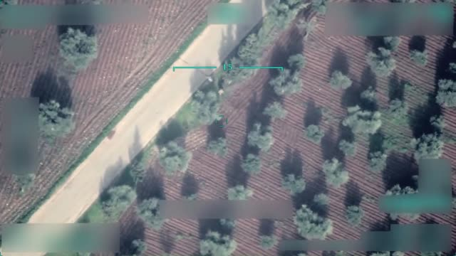 a video shot by a drone of turkish armed forces shows that pyd/pkk terrorists are setting bombs at the exit point of qurayriah village in syria's... - terrorismus stock-videos und b-roll-filmmaterial