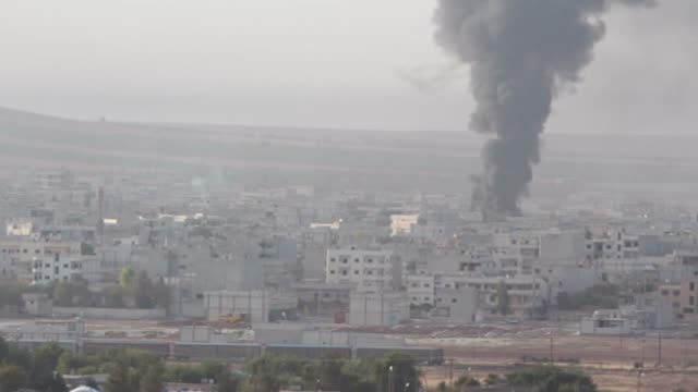 video shot from suruc district of sanliurfa southeastern province of turkey displays smoke rises following the airstrikes carried out by usled... - 武力攻撃点の映像素材/bロール