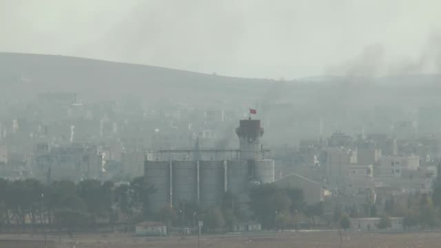 video shot from suruc district of sanliurfa, turkey, near turkish-syrian border crossing shows smoke rising from the syrian border town of kobani... - us state border stock videos & royalty-free footage