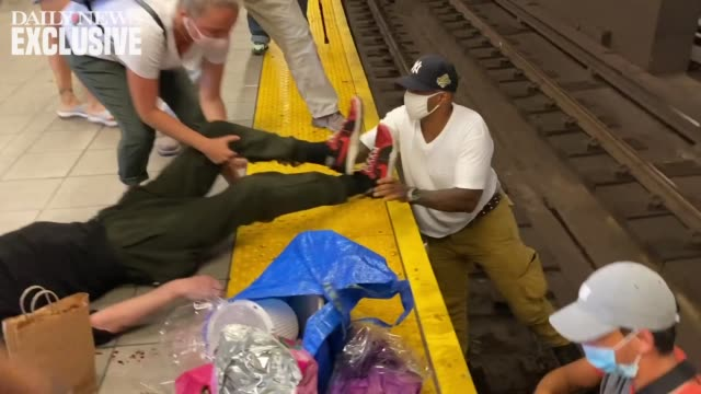 video shows moment a man who fell onto tracks is rescued as subway train arrives at the manhattan-bound a and c train platform at the jay... - danger stock videos & royalty-free footage