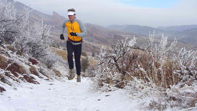hd video snowy colorado rocky mountain red rocks trail run - red rocks stock videos and b-roll footage