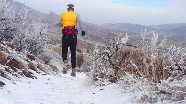 hd video snowy colorado rocky mountain red rocks trail run - red rocks stock videos & royalty-free footage