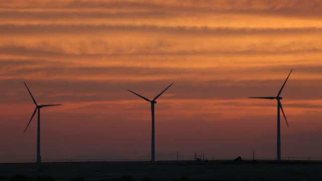 HD video sunset silhouettes Idaho Wind Farm