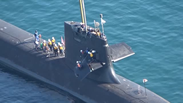 video taken feb. 9 from a kyodo news helicopter shows japanese maritime self-defense force submarine souryu off kochi port, following its collision... - pacific ocean stock videos & royalty-free footage