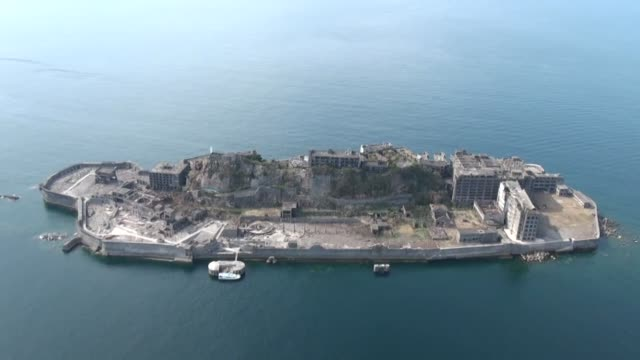 video taken from a kyodo news helicopter on sept. 29 shows world heritage site hashima island, known as battleship island, off nagasaki, southwestern... - fukuoka prefecture stock videos & royalty-free footage
