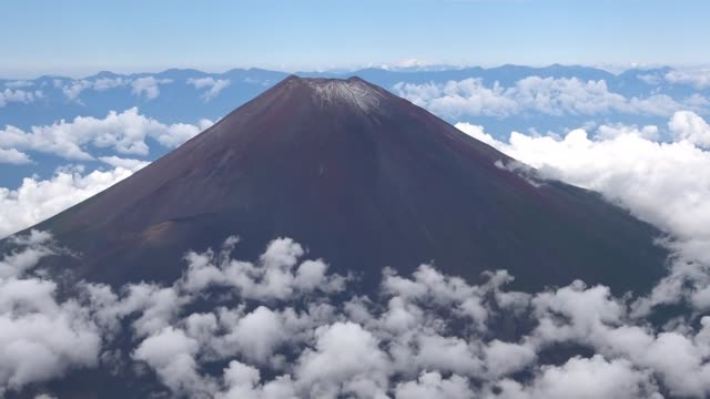 video taken sept. 21 from a kyodo news helicopter over yamanashi prefecture, eastern japan, shows the first snowcap of the season on mt. fuji. - mt fuji stock videos & royalty-free footage