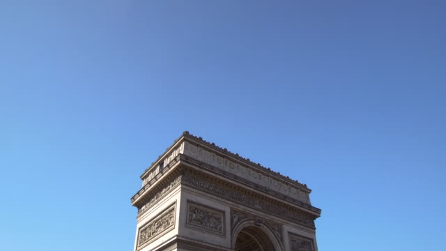video tilting up over the arc de triomphe to the sky in paris, daytime - triumphal arch stock videos & royalty-free footage