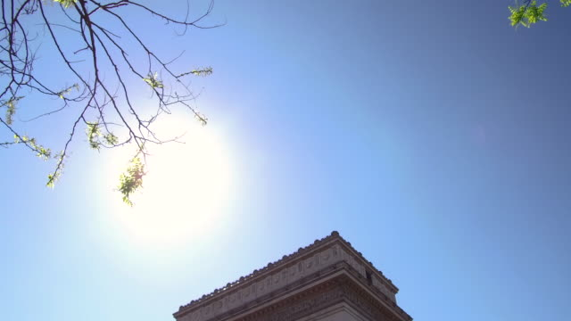 video tilting up over the arc de triomphe to the sky in paris, daytime - french flag stock videos & royalty-free footage