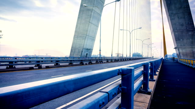 video time lapse of traffic on the bridge. - bugtiger stock videos and b-roll footage