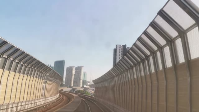 video took on mrt monorail ride in kuala lumpur through smart phone during day - railing stock videos & royalty-free footage
