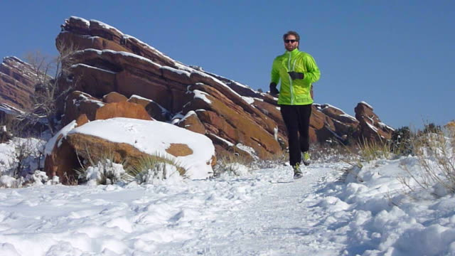 hd video trail runner in snowy red rocks park colorado - red rocks stock videos & royalty-free footage