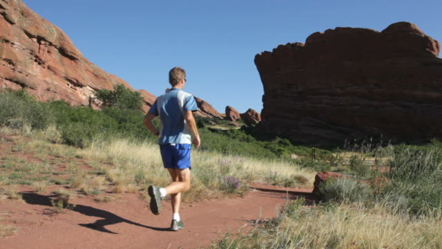 hd video trail running red rocks park colorado - red rocks stock videos and b-roll footage