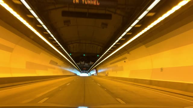 pov video travelling through a road tunnel - built structure stock videos & royalty-free footage
