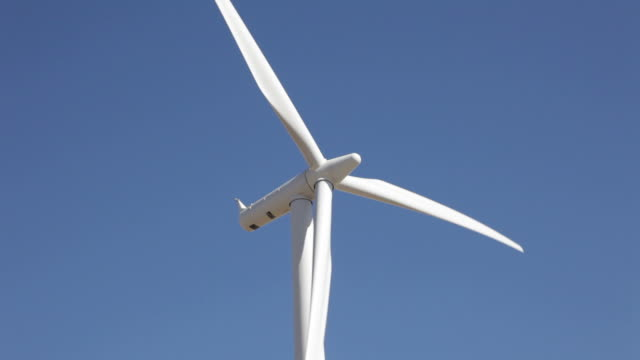 hd video turning peetz wind farm turbine northeastern colorado - general electric stock videos and b-roll footage