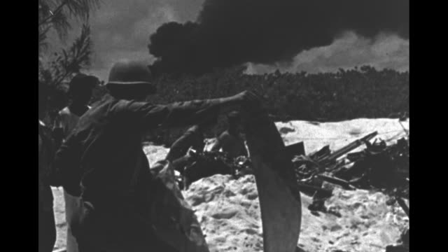 [video unstable at times] world war ii / midway island battle aftermath / propaganda video / odd animal in fg with smoking ships in bg / bird with... - battle stock videos & royalty-free footage