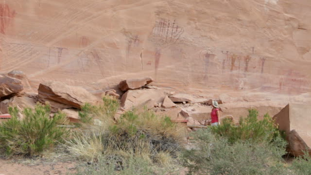 hd video visitor at buckhorn petroglyphs utah - san rafael swell stock videos and b-roll footage