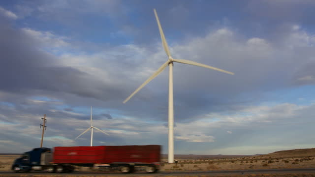 hd video wind turbines spin along colorado highway - pronghorn stock videos & royalty-free footage