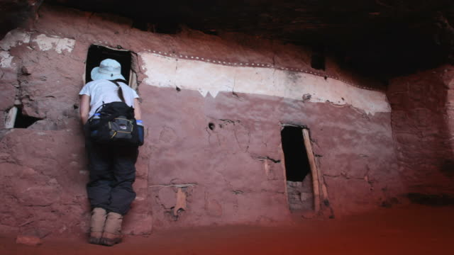 HD video woman explores ancient Pueblo homes Utah