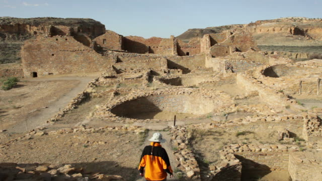 hd video woman explores ancient ruins chaco canyon nhp - chaco culture national historical park stock videos & royalty-free footage