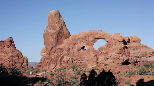 hd video woman explores arches national park utah - sandstone stock videos and b-roll footage