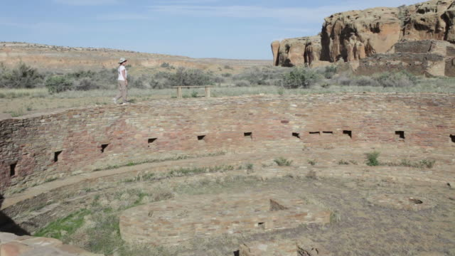 hd video woman explores kiva in chaco canyon nhp - chaco culture national historical park stock videos & royalty-free footage