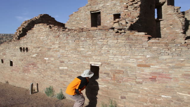 hd video woman explores pueblo ruin chaco canyon nhp - chaco canyon stock videos & royalty-free footage