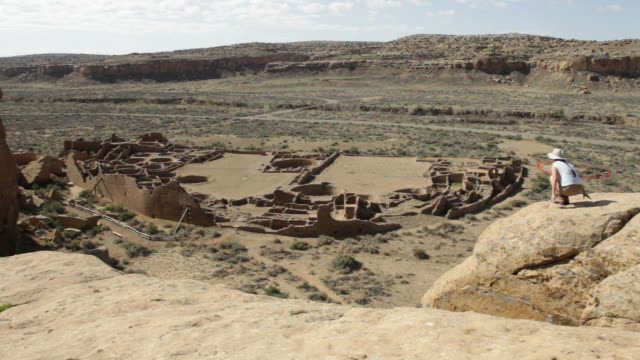 HD video woman hikes overlook in Chaco Canyon NHP