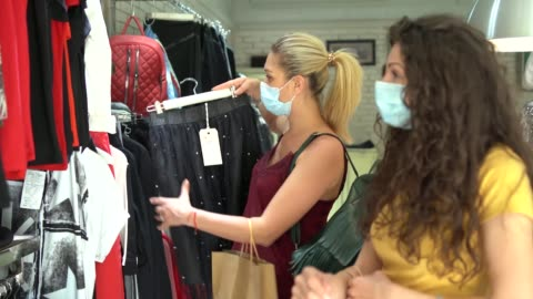 4k video womеn wearing protective mask and shopping after reopening stores after covid-19 - boutique stock videos & royalty-free footage