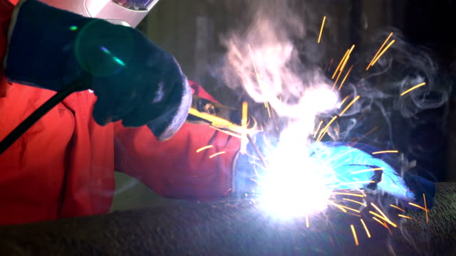 4k video : worker welding the steel part - automobile industry stock videos & royalty-free footage