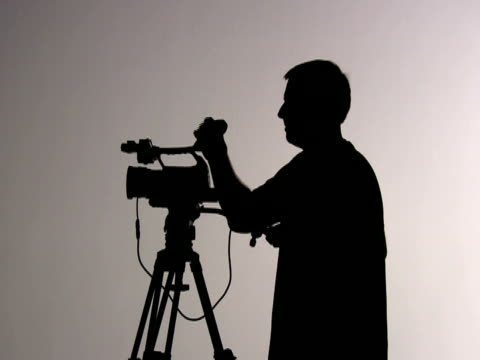 Videographer Cameraman Shooting and Directing; Silhouette