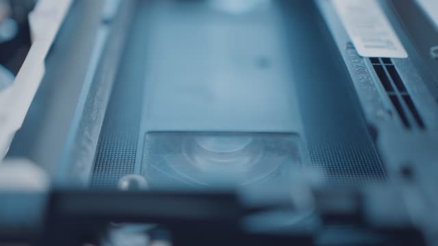 a vhs videotape playing inside an old vcr home video player on july 21 2020 - retro style stock videos & royalty-free footage