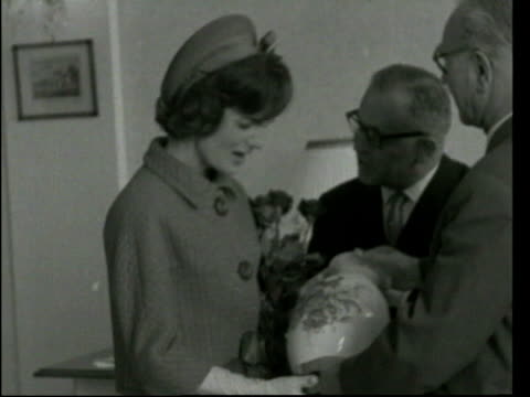 may; in 1994 jacqueline kennedy onassis died lib austria: vienna: b/w footage jackie kennedy receiving vase during visit to pottery - jackie kennedy stock videos & royalty-free footage