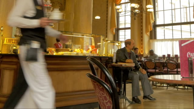 Vienna cafe with waiter.Pan left to right.Medium shot