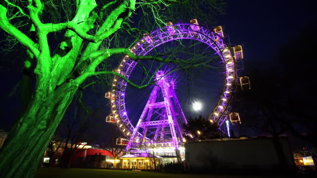 wiener riesenrad illuminated - prater park stock videos & royalty-free footage
