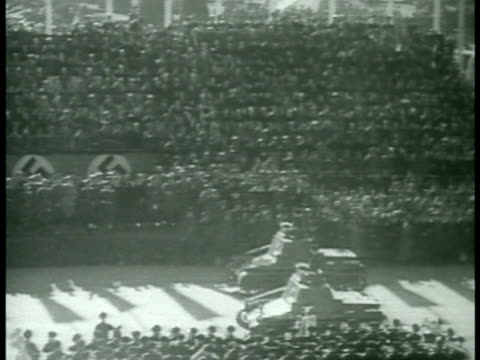 stockvideo's en b-roll-footage met people gathering at austrian parliament building tanks moving on street in front of museum of natural history tanks rolling on street uniformed men... - 1938