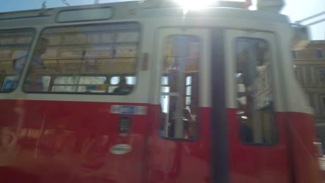 vienna,austria,street tram pullling into station.pan - vienna austria stock videos & royalty-free footage