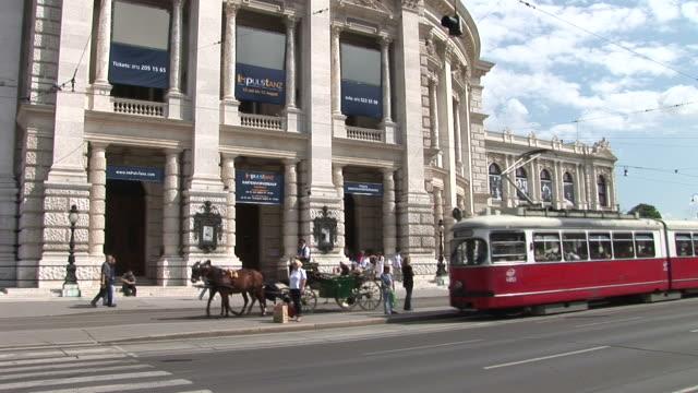 viennafront view of hofburg theatre in vienna austria - österreichische kultur stock-videos und b-roll-filmmaterial