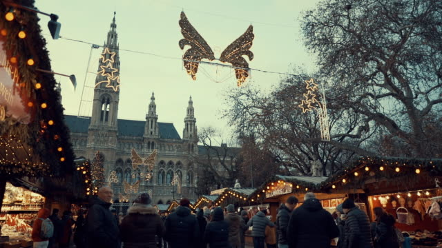 vienna's rauhaus during the christmas market in winter, seat of mayor and city council. christmas crowd front of vienna city hall. - vienna austria stock videos & royalty-free footage
