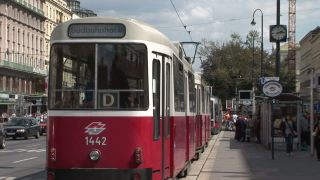 viennaview of a tram stop in vienna austria - tram stock-videos und b-roll-filmmaterial