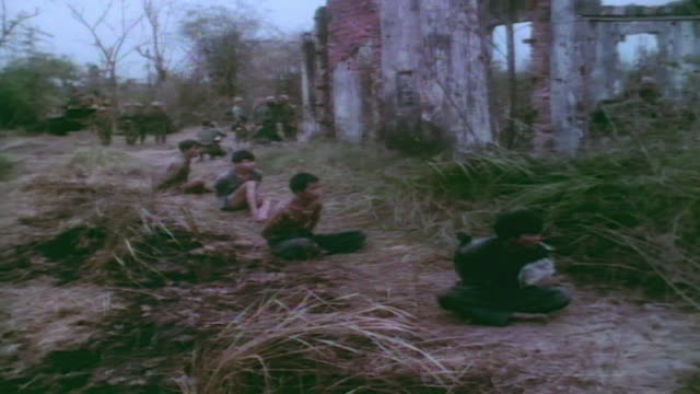 viet cong prisoners of war crouching with hands bound behind them / vietnam - desaturated stock videos & royalty-free footage
