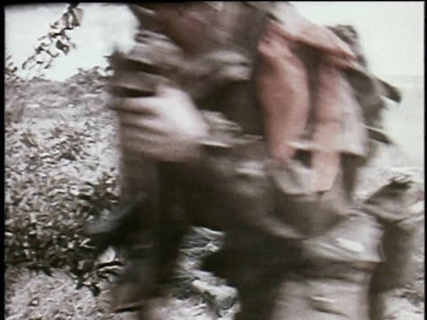 viet cong running on beach / viet cong camouflaged and walking through jungle / viet cong shooting into brush - ベトコン点の映像素材/bロール