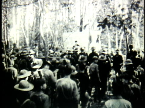 vídeos de stock, filmes e b-roll de viet cong soldiers at conference at forest camp / vietnam - 1964
