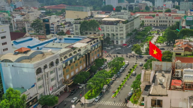 A Viet Nam flag waves over the Nguyen Hue Street in Ho Chi Minh City, Viet Nam.