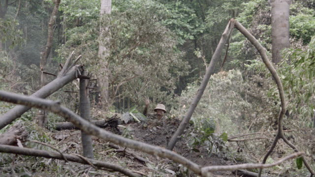 a vietcong soldier hides in a trench as he throws a grenade. - 1987 stock videos & royalty-free footage