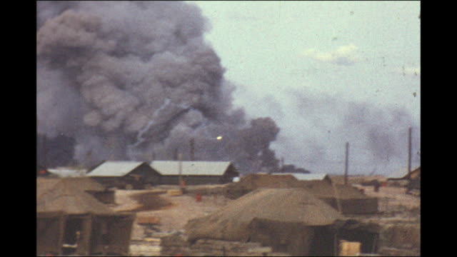 vietnam amateur footage by a marine in 1970 / distant mortar fire and firey explosions/ marine camp barracks and tents / rolling skyward explosions... - ベトナム戦争点の映像素材/bロール
